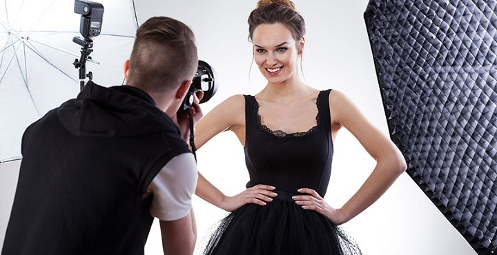 29490784 - fashion photographer and model working together, horizontal
